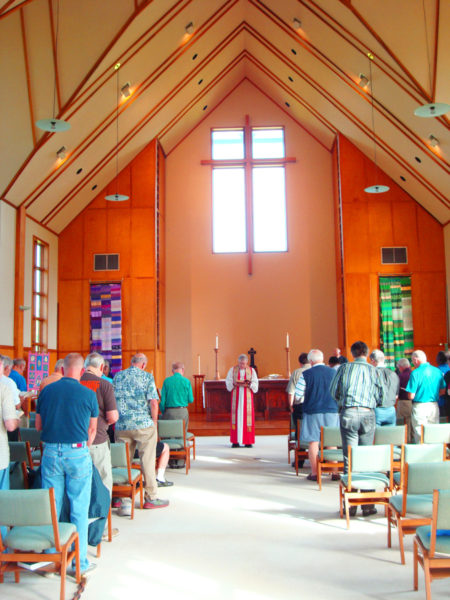 Bishop Duncan Gray III celebrates Eucharist with the Brotherhood of St. Andrew during its national council meeting at the Bishop Duncan Gray Camp and Conference Center near Canton, Mississippi. Photo: Jim Goodson