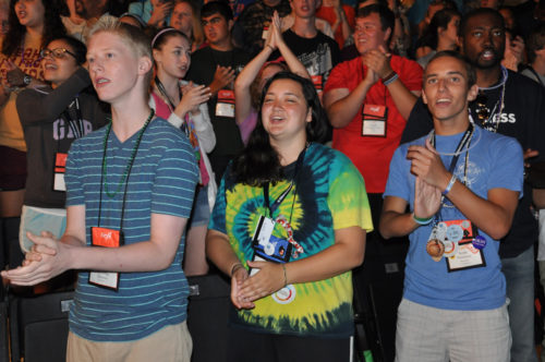 A few of the 786 youth attending the Episcopal Youth Event 2014 Opening Eucharist July 10 at the sports arena on the campus of Villanova University near Philadelphia, Pennsylvania, sing and sway to the communion music. Photo: Mary Frances Schjonberg/Episcopal News Service