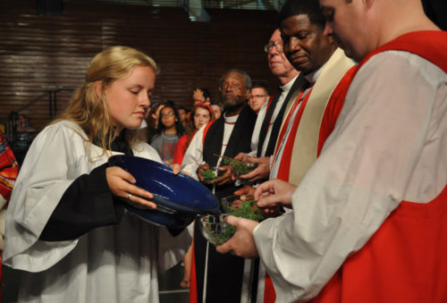 Acolyte Lillian Hardaway, a member of the Episcopal Youth Event 2014 planning team from the Diocese of Upper South Carolina, fills a bowl with holy water for Diocese of Central Pennsylvania Bishop Sean Rowe as she had just done for Maryland Bishop Eugene Sutton (to Rowe's right), Pennsylvania Bishop Clifton Daniel and North Carolina Bishop Michael Curry. Photo: Mary Frances Schjonberg/Episcopal News Service