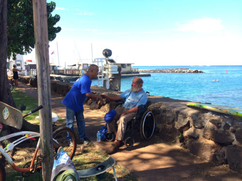 ACCW volunteer driver BJ Santiago offers food and other personal care items to Charles near Lahaina. Photo: Keith Yamamoto