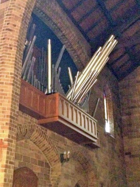 Just after the Aug. 24 earthquake, the pipes were still in the organ loft, however precariously. Either gravity or aftershocks or some combination of those forces sent some pipes tumbling to the chancel floor. Photo: St. Mary's Episcopal Church via Facebook.