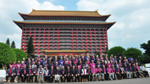 Bishops attending the Episcopal Church House of Bishops meeting in Taipei, Taiwan pose for a group photo on Sept. 17 outside the historic Grand Hotel, site of the meeting. It was 97 degrees at the time of the photo session, which considering the 50 percent humidity, felt like 109. Photo: Mary Frances Schjonberg/ Episcopal News Service