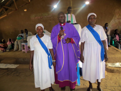 Bishop Andudu Elnail of Kadugli and South Sudanese members of the Mothers' Union participate in a worship service at the Kakuma Camp in Kenya.