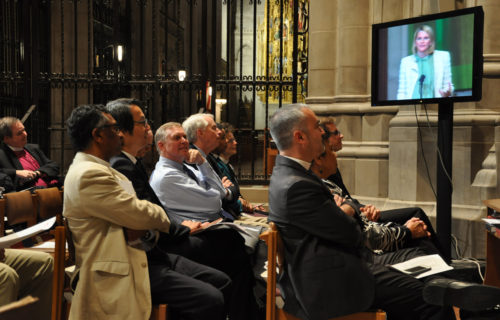 Some members of the Task Force for Reimagining the Episcopal Church listen Oct. 2 at Washington National Cathedral as co-convener Katy George, on monitor, speaks about the organizational perspective of TREC's work. Photo: Mary Frances Schjonberg/Episcopal News Service