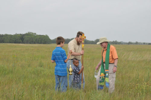 The Rev. Peter Conaty blesses the Nash Prairie at a special service with church members and The Nature Conservancy.  Photo: Diocese of Texas