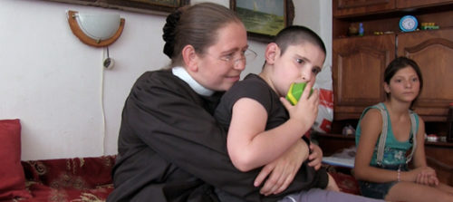 Every week or two, the Rev. Dorothee Hahn visits Cosmin and his family near Huși, Romania. Cosmin suffered an undiagnosed illness when he was about 18 months old and has been disabled every since. Photo: Matthew Davies
