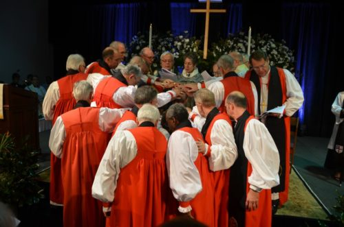 Several bishops lay their hands on Robert Skirving as he consecrated as the 8th bishop of the Diocese of East Carolina. Photo: Richard Schori