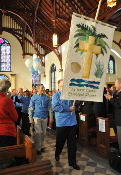 Members of the Episcopal Church of the Messiah in Myrtle Beach, South Carolina march up the aisle of Church of the Holy Communion in Charleston Nov. 15 to be welcomed as a mission congregation of the Episcopal Church in South Carolina. Photo: Mary Frances Schjonberg/ENS