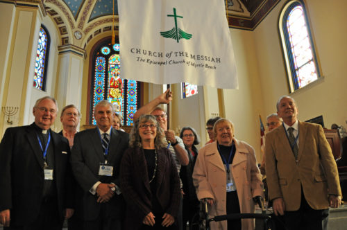 Members of the East Cooper Episcopal Church in the Charleston area accept applause at Church of the Holy Communion in Charleston Nov. 15 after being officially welcomed as a mission congregation of the Episcopal Church in South Carolina. Photo: Mary Frances Schjonberg/ENS