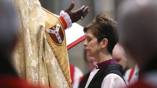 Archbishop of York John Sentamu prays over the Rev. Libby Lane during her ordination and consecraion as the first female Bishop in the Church of England at York Minster in York, northern England Jan. 26. Photo: Reuters/Lynne Cameron