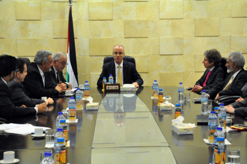 Palestinian Prime Minister Rami Hamdallah welcome the delegation to the headquarters of the Palestinian Authority in Ramallah on Jan. 22. Photo: Matthew Davies/ENS