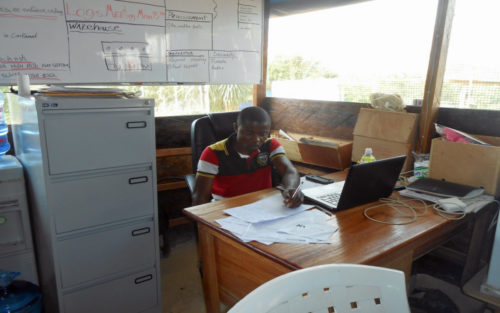 Wonkamah G. Gono, a graduating senior of the business college of Cuttington University, serves as the procurement officer at the Bong County Ebola Treatment Center. Photo: Cuttington University