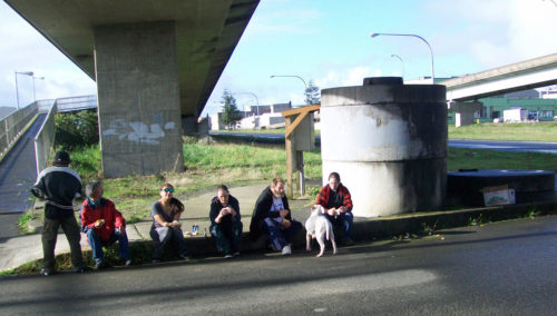 The Rev. Sarah Monroe, far right, began her ministry with homeless people in Aberdeen, Washington, by getting to know the folks who hang out under a bridge that connects two parts of the coastal town southwest of Seattle. Photo: Glenn Stone