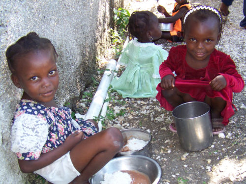 Students have lunch at St. Paul's School in Petit Trou de Nippes, Haiti. The school, founded 25 years ago by the Colorado Haiti Project, provides a nutritious meal to more than 700 students a day. Photo: Colorado Haiti Project