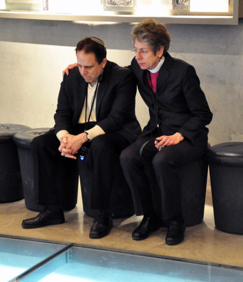 Episcopal Church Presiding Bishop Katharine Jefferts Schori and Rabbi Steve Gutow, president of the Jewish Council for Public Affairs, share a moment of quiet reflection during a visit to Yad Vashem, Israel's memorial to the holocaust. Photo: Matthew Davies/ENS