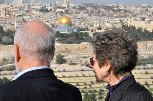 Episcopal Church Presiding Bishop Katharine Jefferts Schori and Rabbi Leonard Gordon, interreligious relations chair for the Jewish Council for Public Affairs, look out over Jerusalem from the Mount of Olives. Photo: Matthew Davies/ENS