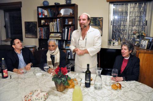 Rabbi Levi Kelman-Weiman welcomes the interfaith pilgrims t his home for Shabbat dinner. Photo: Matthew Davies/ENS