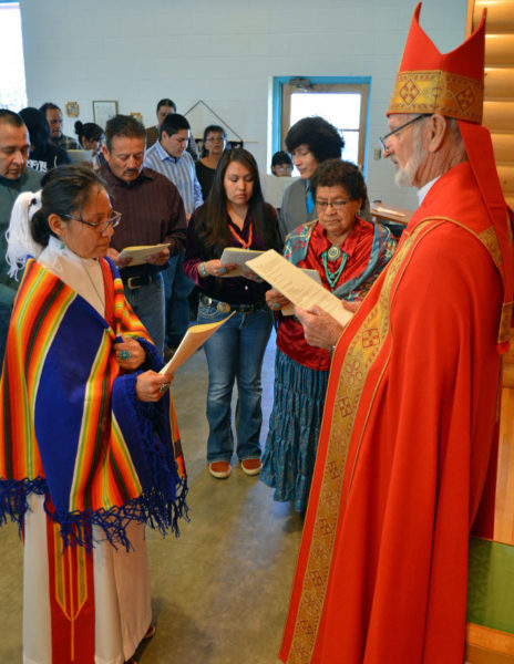 The Rev. Canon Cornelia Eaton is presented to Navajoland Bishop David Bailey for ordination to the priesthood Feb. 7 at All Saints Church in Farmington, New Mexico. Among the presenters is Eaton's mother, Alice Mason (center), who served as lay pastor of St. Michael's Church in Upper Fruitland, New Mexico, for 30 years. Photo: Dick Snyder