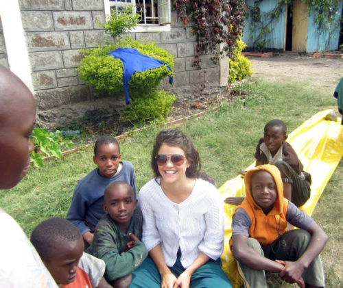 Episcopal Church missionary Natalie Finstad sits and talks with some boys who live at Nyumba ya Tumaini, one of Tatua Kenya's partner organizations. Photo: Tatua Kenya