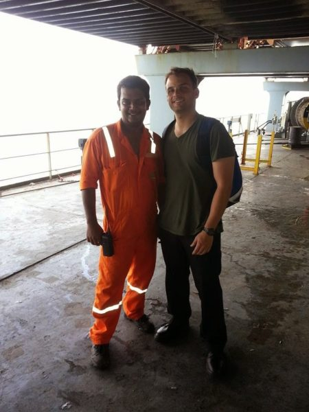 Will Bryant, Young Adult Service Corps missionary from the Episcopal Diocese of Western North Carolina, poses for a photo with a seafarer and friend during his year in service with the Mission to Seafarers in Hong Kong.