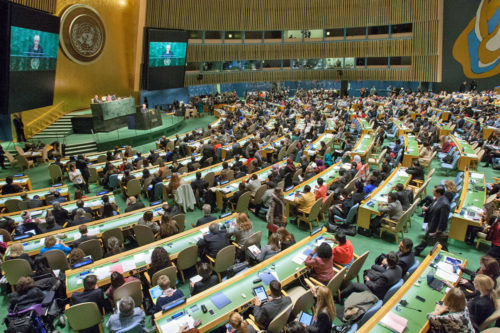 Participants gather in the United Nations' General Assembly Hall during the opening of the fifty-ninth session of the Commission on the Status of Women (CSW). Taking place at UN headquarters from March 9-20, the session will review progress made in the implementation of the Beijing Declaration and Platform for Action, 20 years after its adoption at the Fourth World Conference on Women in 1995. Photo: United Nations