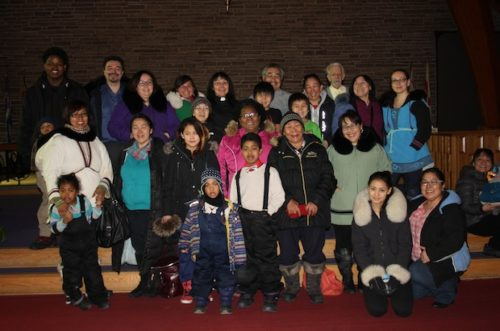 Members of Annie Ittoshat's first Montreal congregation gather for a group photo. Ittoshat is fifth from the left in a clerical collar; her husband, Noah, is next to her. Photo: Harvey Shepherd