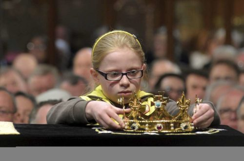 Emma Chamberlain, 9, from Aylestone (a suburb of Leicester) and a member of the 1st Aylestone Brownies, places a crown on Richard III's casket March 22 after it was brought to Leicester Cathedral. Photo: King Richard in Leicester website (http://kingrichardinleicester.com/)