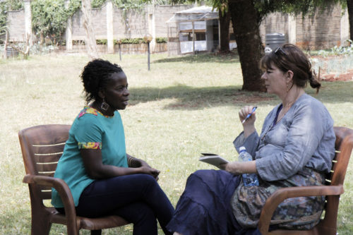 Alice Eshuchi, country director for Heshima Kenya, talks with Alyssa Stebbing, outreach director for Trinity Episcopal Church of The Woodlands in the Diocese of Texas, during a visit to Heshima's operations office in Nairobi. Heshima Kenya specializes in identifying and protecting unaccompanied and separated refugee children and youth, especially girls, young women and their children living in Nairobi. Photo: Lynette Wilson/ENS