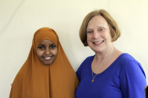 A Somali refugee woman who works as a community health worker poses with Cookie Cantwell, during a visit to Refuge Point, an organization that works to empower some of the most vulnerable refugees in Nairobi and other locations worldwide. Photo: Lynette Wilson/ENS