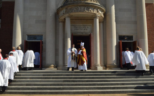 Atlanta Bishop Rob Wright, right, and Rabbi Peter S. Berg, leader of The Temple, a Reform synagogue in Midtown Atlanta, talk outside The Temple March 31 as Episcopal Church clergy enter for the traditional Holy Tuesday renewal of vows. Berg preached at the service. Photo: Diocese of Atlanta