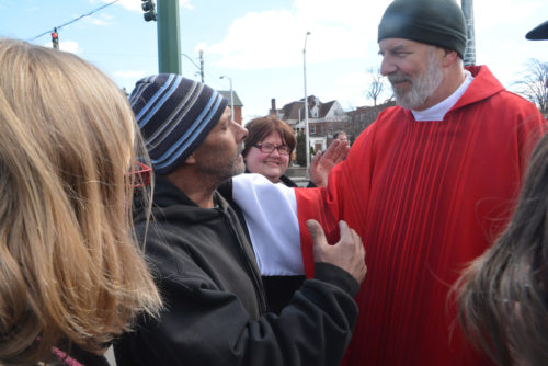 Ken Baker, a resident of Hartford, Connecticut, greets Bishop Jim Hazelwood, right, of the New England Synod of the Evangelical Lutheran Church in American, and asks him for a hug. The bishop was with a group of clergy returning from a visit to Hartford Hospital. Photo: Diocese of Connecticut