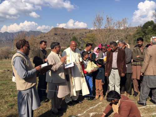 The Very Rev. Patrick Augustine, rector of Christ Episcopal Church in La Crosse, Wisconsin, lays the foundation stone for a new Christian church near Muzzaffarabad during a recent solidarity visit to Pakistan.