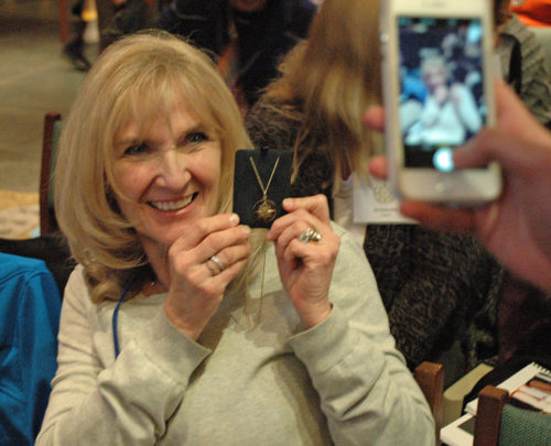 Beth Adamson poses with the Award for Global Service that was recently presented to her by the nglican Communion Office at the United Nations. Photo;maryFrances Schjonberg/Episcopal News Service