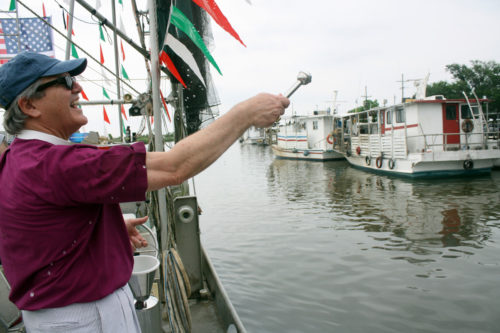 The Rt. Rev. Morris K. Thompson Jr., Bishop of Louisiana, during the blessing of the fleet along the muddy waters of Bayou Dularge. Photo: Karen Mackey