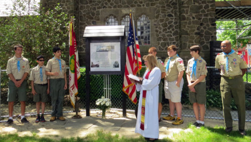 The Rev. Audrey Hasselbrook, assistant rector at St. James Episcopal Church in Upper Montclair, New Jersey, dedicates a marker erected by Boy Scout C.J. Kaloudis to highlight the bell tower's history as a memorial to World War I soldiers. Photo: Dom Gerard