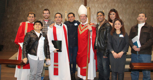 "Diocese of Olympia Bishop Greg Rickel poses with the Rev. Alfredo Feregrino, founder of Our Lady of Guadalupe in Seattle, and members of the congregation. Feregrino calls a ""bicultural-bilingual progressive ministry in the Anglo Catholic tradition that focuses on urban Latinos, New Generation Latinos and a bilingual and bicultural population, including Anglos and non-Latinos.""  Photo: Our Lady of Guadalupe"