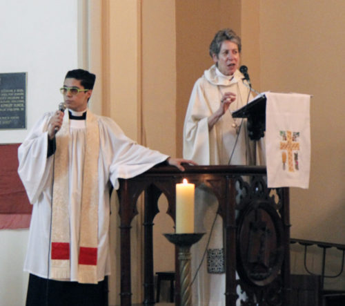 Presiding Bishop Katharine Jefferts Schori preached during the June 7 Eucharist at Most Holy Trinity Cathedral in Porto Alegre, Brazil, the birthplace of the Episcopal Anglican Church of Brazil. The Rev. Luiz Coelho, of the Diocese of Rio de Janeiro, translated the sermon from English to Portuguese. Photo: Lynette Wilson/ENS