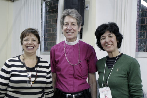 The Rev. Carmen Gomes, the first female priest ordained in the Episcopal Anglican Church of Brazil, Presiding Bishop Katharine Jefferts Schori, and Christina Takatsu Winnischofer, president of the Episcopal Anglican Church of Brazil's Women's Union and the church's former general secretary, pose for a photo during a June 6 conference of lay and ordained women theologians in Porto Alegre, Brazil. Photo: Lynette Wilson/ENS