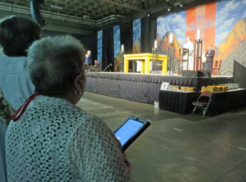 For the first time, this General Convention is not using printed worship bulletins for the daily Eucharists. Worshipers accessed the order of worship via electronic devices during the opening service on June 25. Photo: Sharon Sheridan/ Episcopal News Service