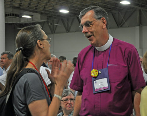The Rev. Ruth Meyers, chair of the Standing Commission on Liturgy and Music in the last two triennia, and  Diocese of Vermont Bishop Tom Ely, a member of that committee, discuss the U.S. Supreme Court marriage equality ruling before the June 26 Eucharist in the General Convention worship hall. Photo: Mary Frances Schjonberg/Episcopal News Service