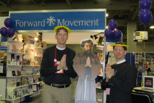 The Rev. Scott Gunn, left, and the Rev. Tim Schenck – the dynamic duo behind Lent Madness – strike a saintly pose with the winner of the 2015 Golden Halo, St. Francis of Assisi, in the Exhibit Hall at General Convention in Salt Lake City. Photo: Sharon Sheridan / Episcopal News Service