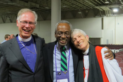 Diocese of California Bishop Marc Handley Andrus, celebrant at the Integrity Eucharist, left, and Diocese of Los Angeles Bishop Suffragan Mary Douglas Glasspool greet Presiding Bishop-elect Michael Bruce Curry of the Diocese of North Carolina after the June 29 worship service. Photo: Sharon Sheridan/Episcopal News Service