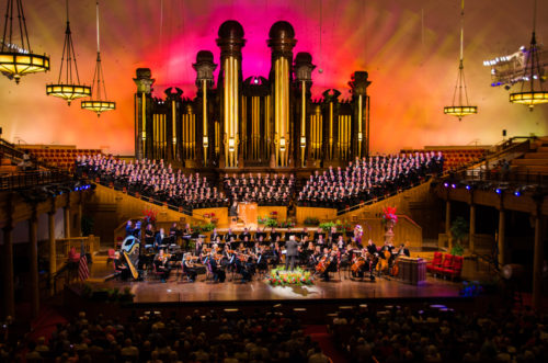 The golden pipes of the Tabernacle organ make a backdrop for the American Festival Choir and Orchestra. Diocese of Utah/Chloe Nguyen