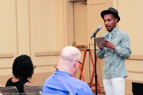 Kevin Smallwood reads a reflection about being racially profiled by hotel security. Photo: Lynn Collins