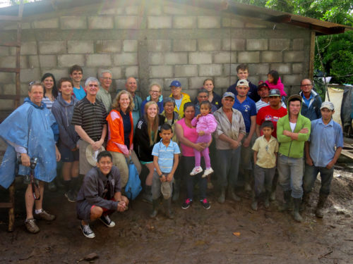 Trip participants and the beneficiary family celebrating the completion of the house. Photo: Linnet Tse