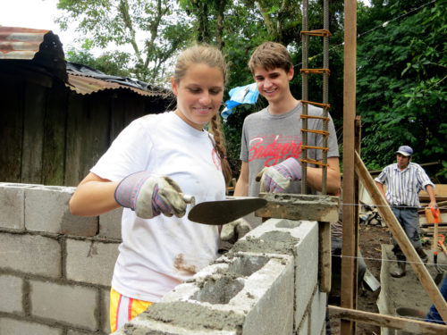 Third-time trip participant Freya Cantwell and second-time trip participant Axel Steinmetz, building the walls of the house. Photo: Linnet Tse