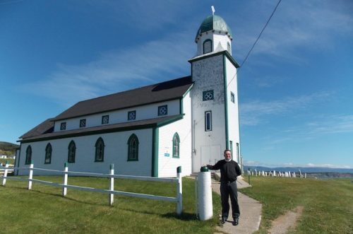 Fr. Steven Maki, the Episcopal rector of Grand Bay parish, at the entrance to Holy Trinity, the parish's oldest Anglican church. Photo: Kat Findlay