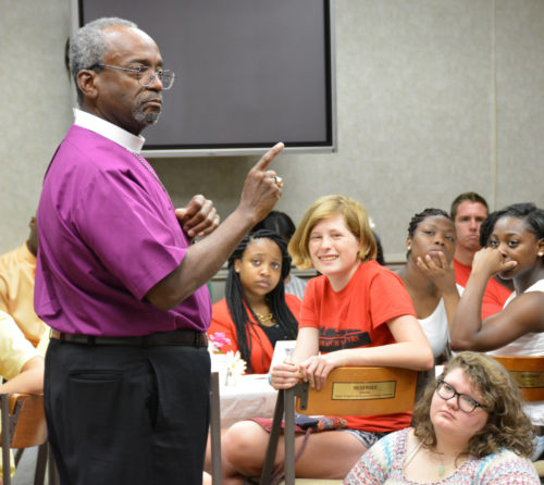 Presiding Bishop-elect Michael Curry speaks during a breakfast for young participants in the Aug. 15 pilgrimage to commemorate Jonathan Daniels and the other martyrs of the civil rights movement in Alabama. Curry later said in his sermon that the gathering reminded him it was time to pass the torch to a new generation who will continue the struggle for equal rights. Photo: Ellen Hudson/Diocese of Alabama