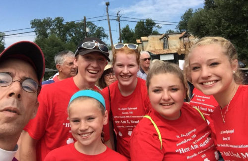 Diocese of Mississippi Bishop Brian Seage poses during the Aug. 15 pilgrimage with some youth group members from St. James Episcopal Church in Keene, New Hampshire. The parish sponsored Jonathan Daniels for ordination. Photo: Brian Seage via Twitter