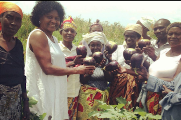 PWRDF staff Zaida Bastos (2nd from left) stands with a number of farmers holding freshly picked eggplants. The farmers, who are HIV-positive, are part of a PWRDF-supported farmers' association in Rugombo, Burundi. Photo: Contributed